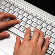 Image of fingers typing on a keyboard